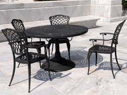 heavy duty patio furniture with black round metal patio table and concrete tiles material black garden furniture