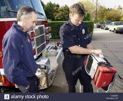 hendry left stock photos hendry left stock images alamy piedmont fire capt dave swan left and firefighter paramedic robb hendry look