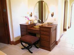 m art deco brown stained teak wood dressing table with drawers combined with oval nickel frame wall mirror among antique wall ligth 840x630 art deco mahogany framed office chair