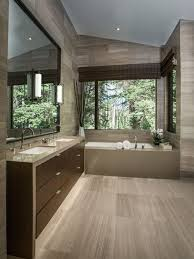 a contemporary bathroom with the same floor and wall treatment bathroom vanity lighting tips
