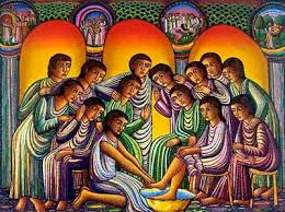a colorful painting of Jesus washing the feet of one disciples, surrounded by all the disciples looking on.