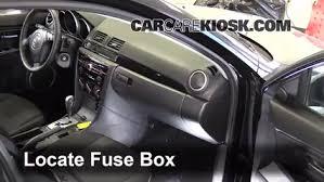 interior fuse box location 2004 2009 mazda 3 2009 mazda 3 s 2 3 locate interior fuse box and remove cover