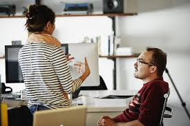 ways to develop effective coworker relationships coworkers discussing project in startup office