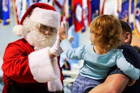 u s department of defense photo essay santa claus high fives a young girl during the alaska national guard warrior and family