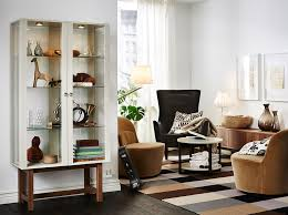 bedroom furniture ikea decoration home ideas: a living room furnished with a glass door cabinet with solid ash legs and two