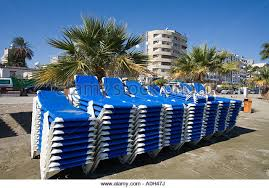 patio furniture ukgujg x a stack of blue deck chairs at larnaka town beach opposite the shops a