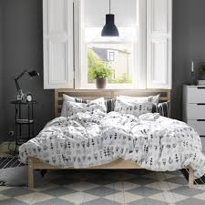 astonishing ikea bedroom design with chess patterned carpet floor under natural brown finish mahogany wood bed frame which has cool duvet cover plus round astonishing ikea stand
