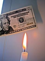 Image result for images of money being set on fire