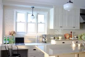 beautiful white kitchen cabinets:  cabinets simple white tile backsplash kitchen with smart windows