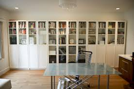 ikea billy bookcase with glass doors in a simple contemporary home office bookcases for home office