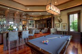 game room lighting ideas family room traditional with gray suede glas front cabinets amazing family room lighting