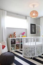 adorable ideas modern baby nursery ideas oval bed design perfect decorating room kids stripes large rugs baby nursery girl nursery ideas modern