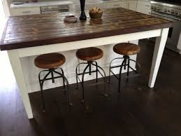 rustic kitchen island: hypnotic solid wood kitchen islands from white laminate furniture using end grain countertop with edge tape and round bar stools with iron legs on top of