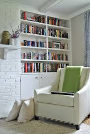 l simple home library design for small space with wall bookshelves built in white painted cabinets using solid brushed cup pulls handle and white leather built home library