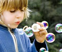 people autism at a higher risk of premature death mid day daily kid playing soap bubbles