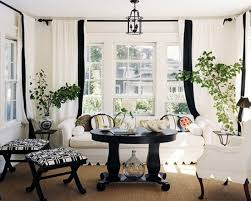 beautiful living room design with black table and white chair furnished with white sofa and window curtains also completed with natural plant as decor ideas beautiful white living room