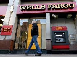 wells fargo gives outgoing exec 124 million despite fraud scheme a man walks past a wells fargo branch in philadelphia on dec 19 2012
