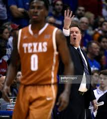 texas v kansas photos and images getty images bill self head coach of the kansas jayhawks sends in signals to his players during a