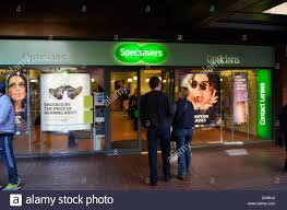 opticians glasses stock photos opticians glasses stock images picture shows couple walking into a specsavers store in enfield town stock image