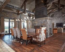 cow hides dining room rustic with ceiling trusses chandeliers cow animal hide rugs home office traditional
