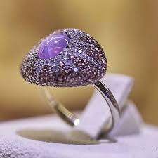 A <b>purple</b> star sapphire surrounded by sapphire pave in a ring by ...