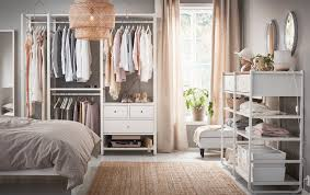 a medium sized bedroom furnished with open floor to ceiling storage consisting of bedroom furniture at ikea