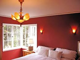 red wall paint black bed: bedroomclassyc style red bedroom wall paint ideas with wooden canopy bed and cone table