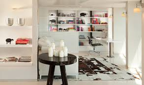 cow hide rugs home office modern with black and white bookcase bookshelves built ins candle holders animal hide rugs home office traditional