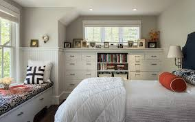 hills beach cottage beach style bedroom idea in portland maine with gray walls and dark hardwood bedroom furniture built in