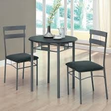 three piece dining set:  piece counter height grey dining set with flower centerpiece full size