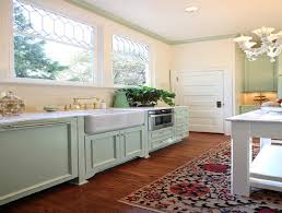 green kitchen cabinets couchableco: pastel green kitchen cabinet with floral rug for charming shabby chic kitchen ideas with beige wall color