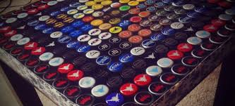 upcycle beer bottle caps into a table doityourselfcom bottle cap furniture