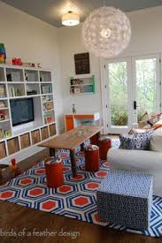 the floor cushionottoman is from homegoods and adds comfy seating in this vibrant playroom bonus room playroom office
