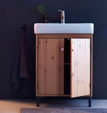washstand bathroom pine: a pine bathroom washstand with a white china sink against a wall