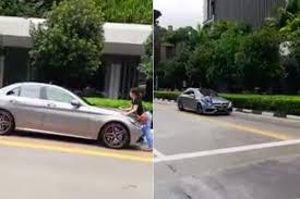 <b>Woman</b> hangs onto <b>Mercedes</b>-<b>Benz's</b> bonnet as it drives down ...