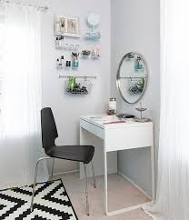 white ikea micke vanity desk in a dressing room with white walls and a round mirror chic ikea micke desk white