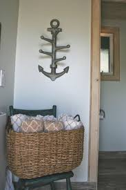 guest bathroom towels: towels are on hand in this pretty basket as you enter after your sauna