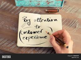 written text pay attention to customer experience stock photo written text pay attention to customer experience