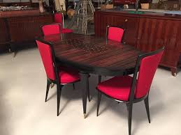 oval dining table art deco:  french art deco maccasar ebony oval dining table with geometric motif