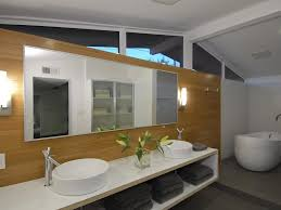 a mid century bath in a ranch style house gets an update with modern vanities and easy to reach storage bathroom mid century