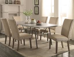 room table displays coaster set driftwood: amherst casual dining table with protected gunmetal tabletop