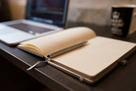 Image result for open notebook on desk