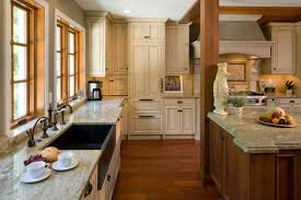 tropical brown granite countertops white cabinet antique white cabinets kitchen mediterranean with exposed beam exposed