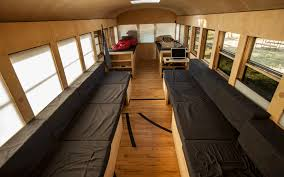 school bus converted into small home by architecture student bedroom converted home