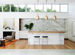 calacatta marble kitchen waterfall: view in gallery marble kitchen with warm and cool tones  spectacular rooms with marble walls