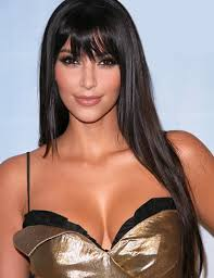 Kim Kardashian bangs sexy gold dress