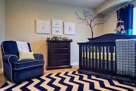 high style nursery mid sized elegant nursery photo for boys in phoenix with beige walls and blue nursery furniture