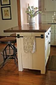 rustic kitchen island: diy kitchen island like this but with a detachable quotleafquot on the other