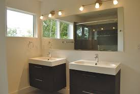 double black wooden vanity with white porcealin trough washstand combined with frameless rectangle mirror and lamp captivating bathroom lighting ideas