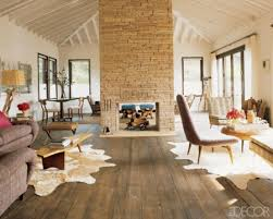 cozy living room with a stacked stone fireplace amazing living room